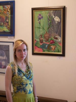 Я с одной из своих картин на выставке